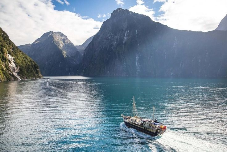 A boat sailing on Milford Sound - image credit Real Journeys